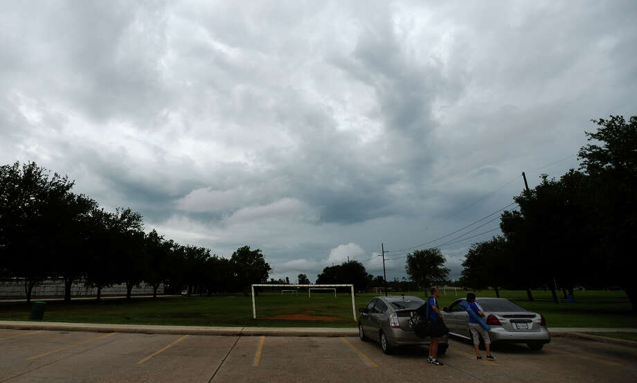 Clouds roll above Babe D. Zaharias Park on Tuesday afternoon. The Beaumont area saw sporadic rain and thunder throughout Tuesday. Photo taken Tuesday 5/27/14 Jake Daniels/@JakeD_in_SETX Photo: Jake Daniels / ©2014 The Beaumont Enterprise/Jake Daniels