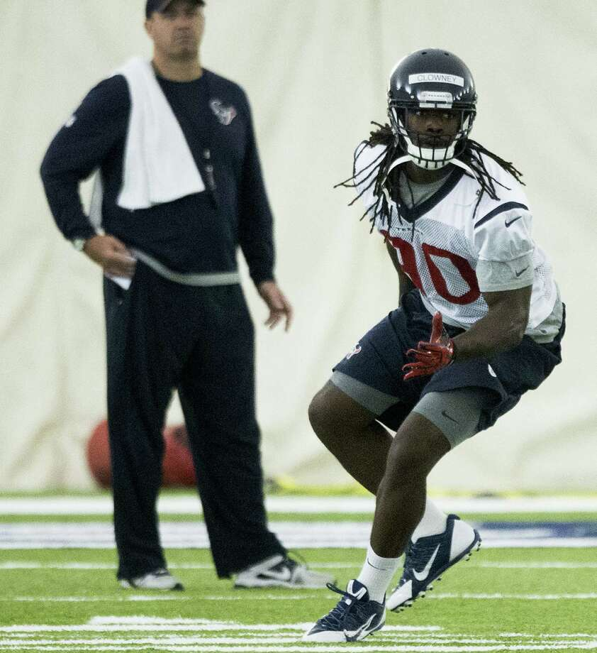 Jadeveon Clowney, the Texans' No. 1 overall draft pick, works out in front of first-year coach Bill O'Brien at organized team activities Tuesday in Houston. Photo: Brett Coomer / Houston Chronicle / © 2014 Houston Chronicle