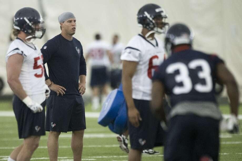 Day 1 - May 27 Texans linebacker Brian Cushing watches practice. Photo: Brett Coomer, Houston Chronicle