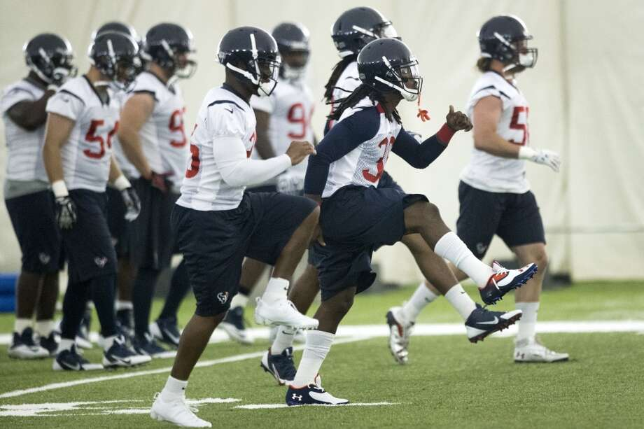 Texans defensive backs Kareem Jackson and D.J. Swearinger run a drill. Photo: Brett Coomer, Houston Chronicle