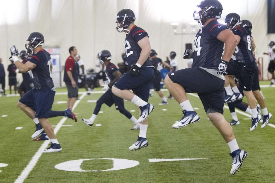 Texans players warm up. Photo: Brett Coomer, Houston Chronicle