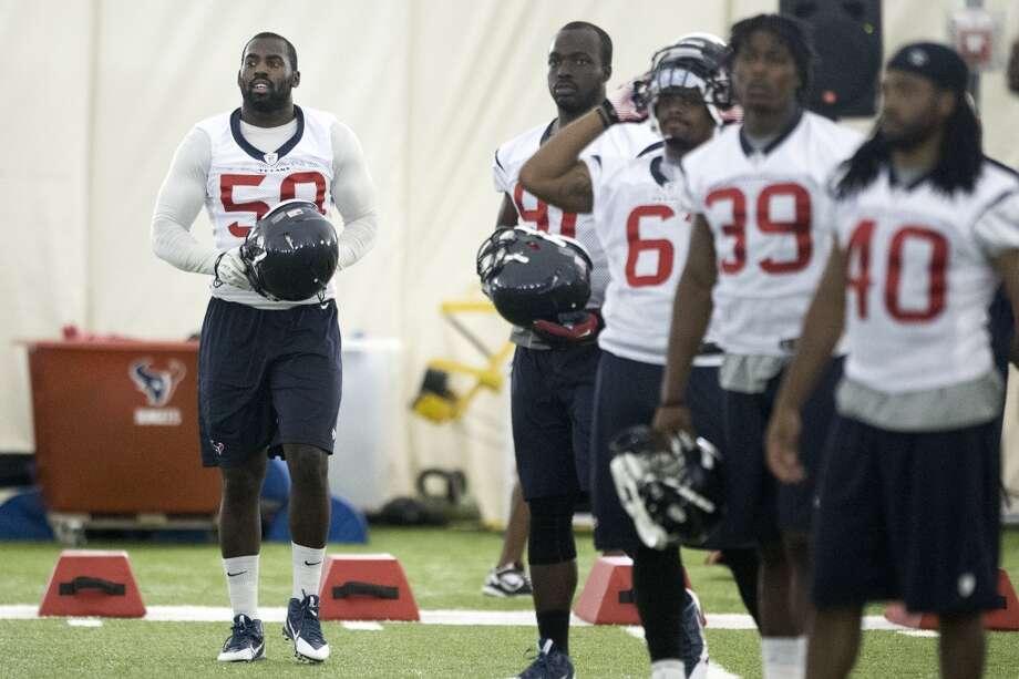 Texans linebacker Whitney Mercilus (59) walks onto the field. Photo: Brett Coomer, Houston Chronicle