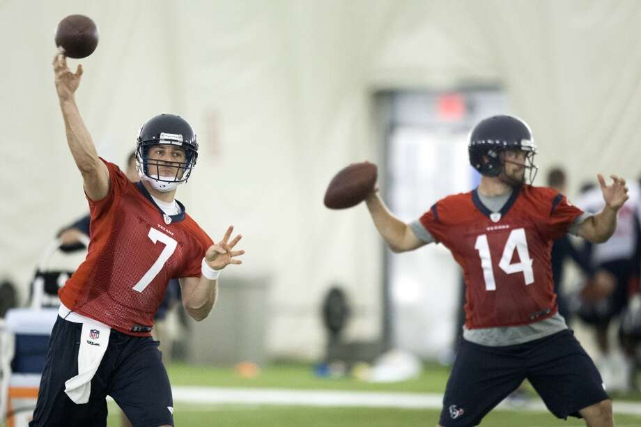 Texans quarterbacks Case Keenum (7) and Ryan Fitzpatrick (14) throw passes. Photo: Brett Coomer, Houston Chronicle