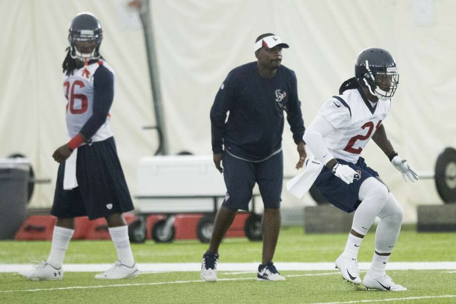 Texans defensive backs D.J. Swearinger (36) and Kendrick Lewis (21) run a drill. Photo: Brett Coomer, Houston Chronicle
