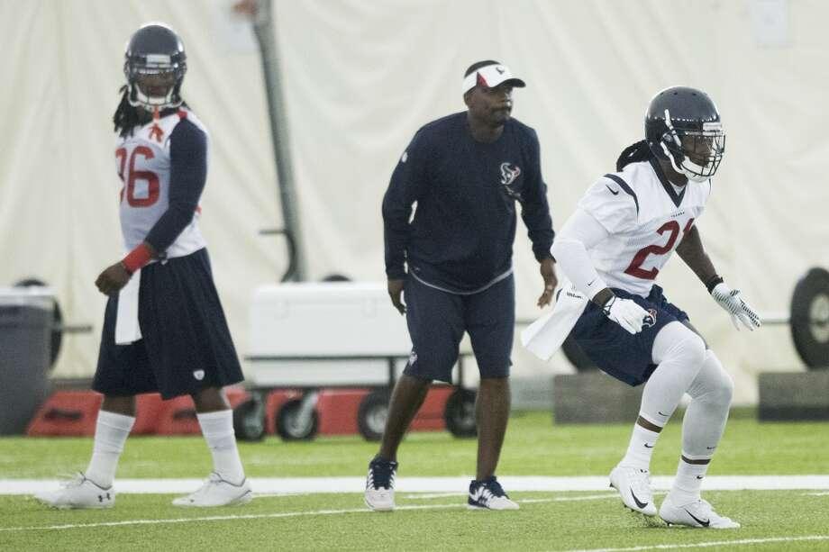 Texans defensive backs D.J. Swearinger (36) and Kendrick Lewis (21) run a drill. Photo: Brett Coomer, Houston Chronicle