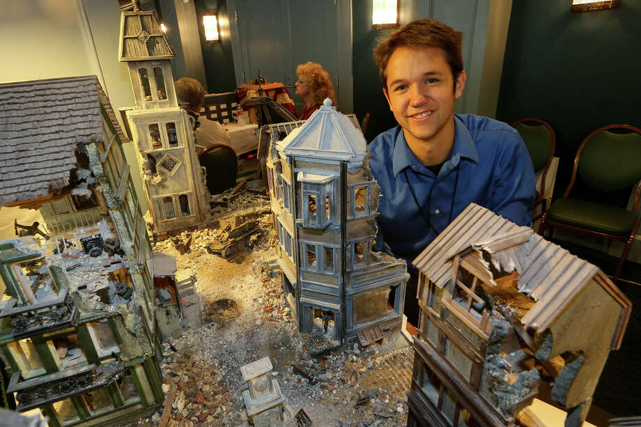 "Andres Flores, 20, from Fort Collins, CO., stands beside a World War II reenactment scene he created called ""Somewhere in Italy, 1942""  at the 2014 Texas Toy Soldier Show at the Menger Hotel on Sunday, May 25, 2014.  Photo by Marvin Pfeiffer / EN Communities Photo: MARVIN PFEIFFER, Marvin Pfeiffer / EN Communities / EN Communities 2014"