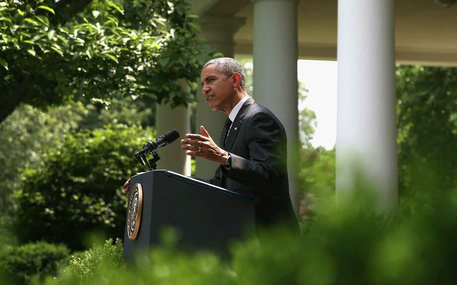 "President Barack Obama said the end of the war in Afghanistan will allow resources to be directed to ""the changing threat of terrorism, while addressing a broader set of priorities around the globe."" Photo: Mark Wilson / Getty Images / 2014 Getty Images"