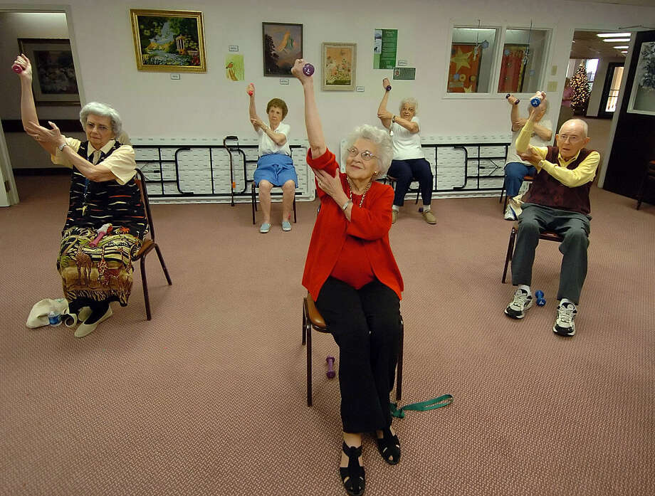 Georgia Hurt (center), 101, exercises with weights during an Charlotte, N.C., exercise class. A study has confirmed the benefits of exercise in the elderly. Photo: Diedra Laird / Charlotte Observer / The Charlotte Observer