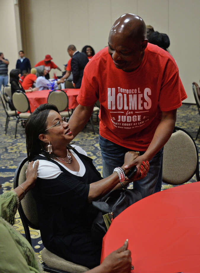 Terrence Holmes shakes Sharon Dozier Davis' hand during Holmes' election night party at the Compro Center Tuesday. Holmes is the popular vote for Jefferson County Court at Law #3 Photo taken Tuesday, May 28, 2014 Guiseppe Barranco/@spotnewsshooter Photo: Guiseppe Barranco, Photo Editor