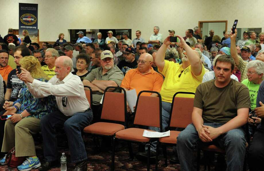 People listen to Former State Senate Majority Leader Joseph Bruno speak during a Gun Rights Rally challenging the Safe Act at the Center Brunswick Fire Department on Tuesday, May 27, 2014 in Brunswick, N.Y.  (Lori Van Buren / Times Union) Photo: Lori Van Buren / 00027063A