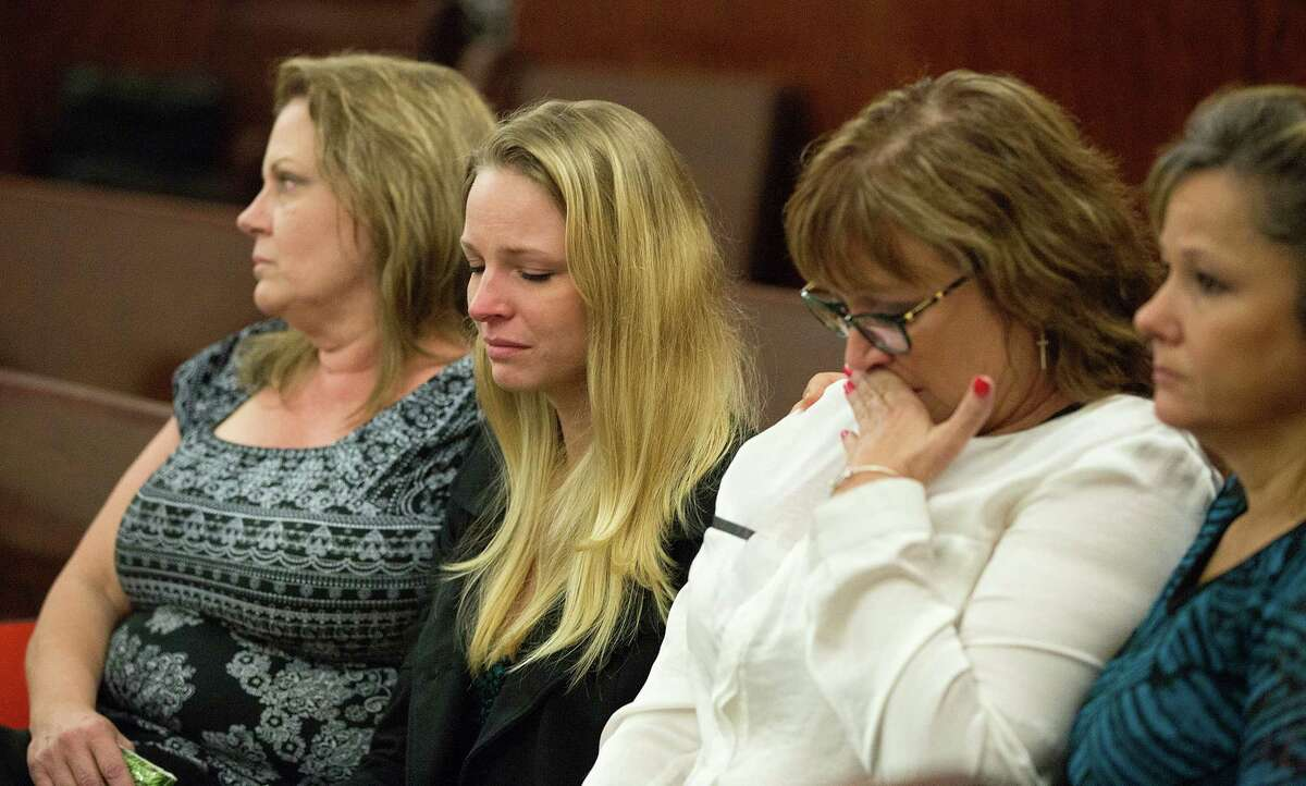 The family of Michelle Warner reacts as Mark Augustin Castellano is walked into the courtroom in the Harris County Criminal Justice Center for opening statements Tuesday. He is accused of killing Warner, his girlfriend, and burying her body in West Texas.