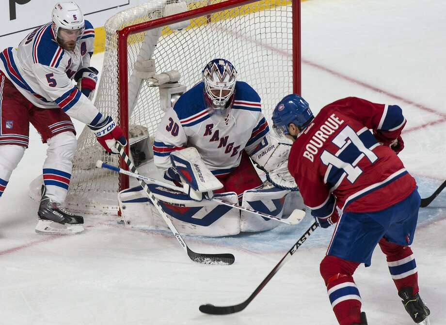 The Canadiens' Rene Bourque scores his first of three goals, beating Rangers goalie Henrik Lundqvist in the second period. Photo: Paul Chiasson, Associated Press
