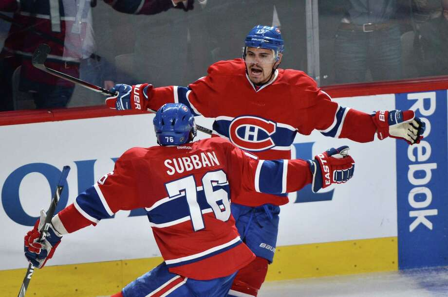 Montreal Canadiens' Rene Bourque, rear, celebrates with teammate P.K. Subban after scoring against the New York Rangers during the third period of Game 5 of the NHL hockey Stanley Cup playoffs Eastern Conference finals, Tuesday, May 27, 2014, in Montreal. (AP Photo/The Canadian Press, Paul Chiasson) ORG XMIT: PCH204 Photo: Paul Chiasson / The Canadian Press