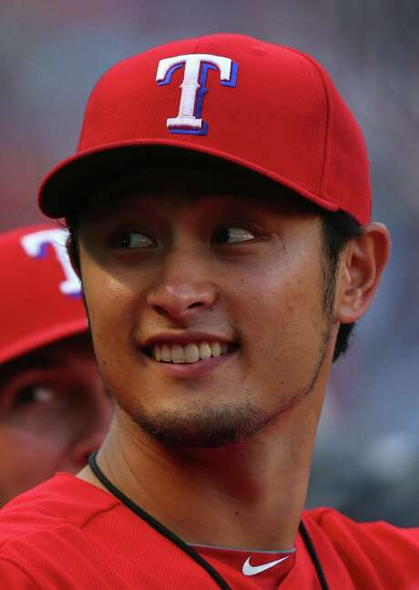 ARLINGTON, TX - MAY 10:  Yu Darvish #11 of the Texas Rangers sits in the dugout during a game against the Boston Red Sox at Globe Life Park in Arlington on May 10, 2014 in Arlington, Texas.  (Photo by Ronald Martinez/Getty Images) Photo: Ronald Martinez, Staff / 2014 Getty Images