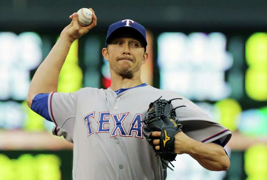 The Rangers' Scott Baker, starting in place of Yu Darvish, gave up two runs on three hits in six innings before the Twins scored twice in the ninth to win. Photo: Jim Mone / Associated Press / AP