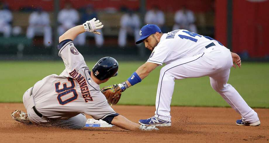 Shortly after driving in the game's first run in the fourth inning, the Astros' Matt Dominguez, left, beats the tag at second applied by the Royals' Omar Infante. The Astros won 3-0 Tuesday for their fourth straight win. Photo: Charlie Riedel, STF / AP