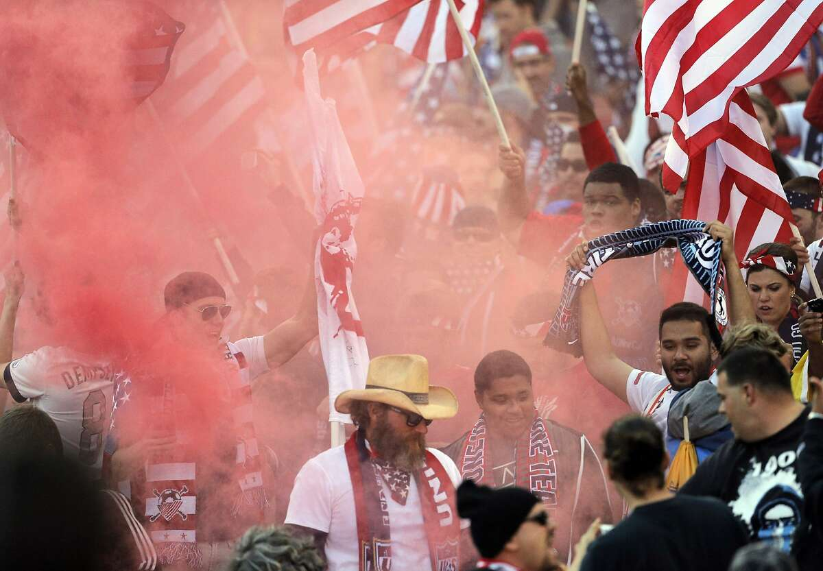 U.S. fans cheer in red smoke from a smoke bomb before the start of the game on Tuesday. The U.S. Men's National Soccer Team played the Azerbaijan Men's National Team at Candlestick Park in an international friendly match on Tuesday, May 27, 2014, in San Francisco, Calif.