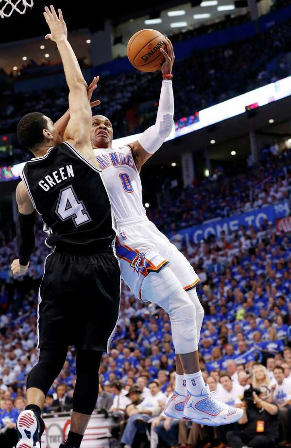 Russell Westbrook, right, fends off a challenge by the Spurs' Danny Green during a 40-point game for the Thunder guard. Photo: Sue Ogrocki, STF / AP