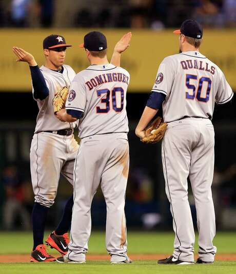 George Springer, left, saw his home run streak end, but that wouldn't prevent a fourth straight Astros win and a postgame celebration with Matt Dominguez. Photo: Jamie Squire, Staff / 2014 Getty Images