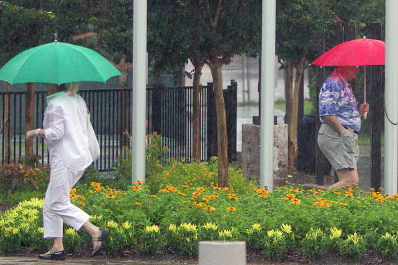 On another rainy day, umbrellas were in vogue Tuesday as voters came and went to cast their votes at the Metropolitan Multi-Services Center,