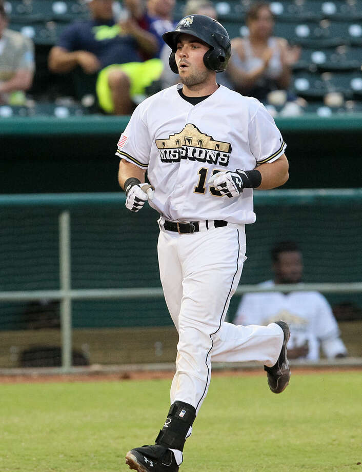 The Missions' Austin Hedges approaches home after hitting a solo shot in the first inning against Northwest Arkansas. It was his fourth long ball. Photo: Marvin Pfeiffer / San Antonio Express-News / Express-News 2014