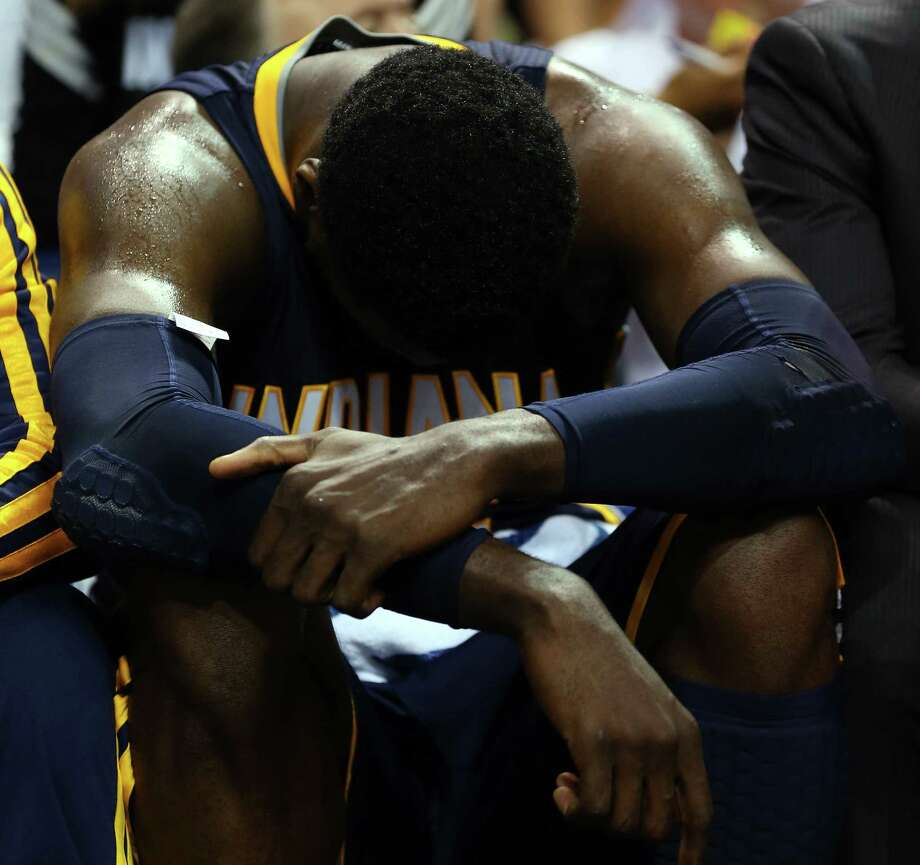 Roy Hibbert hangs his head during his zero-point outing in Game 4. The Pacers trail the Heat 3-1. Photo: Mike Ehrmann / Getty Images / 2014 Getty Images