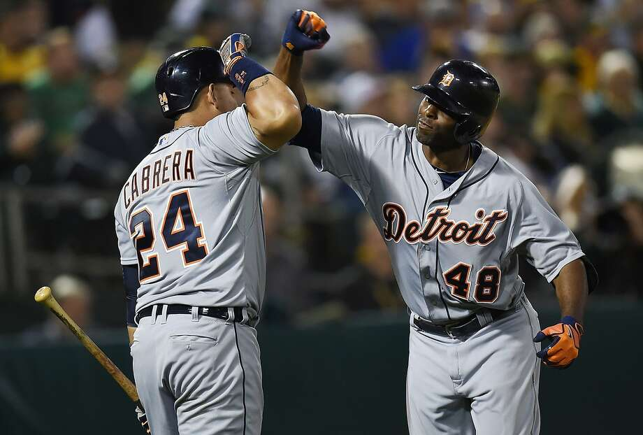 Torii Hunter (right) gets a forearm salute from Miguel Cabrera after Hunter's home run tied the game in the seventh inning. Photo: Thearon W. Henderson, Getty Images