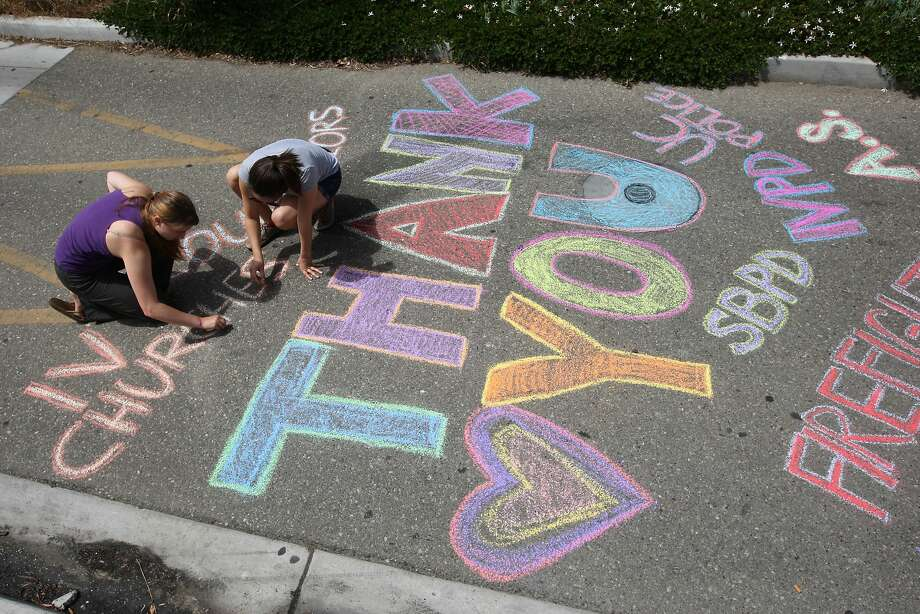 ISLA VISTA, CA - MAY 27:  Students write chalk messages of thanks in the street on the Day of Mourning and Reflection for the victims of a killing spree at University of California, Santa Barbara on May 27, 2014 in Isla Vista, California. Elliot Rodger killed six college students at the start of Memorial Day weekend and wounded seven other people, stabbing three then shooting and running people down in his BMW near UCSB before shooting himself in the head as he drove. Police officers found three legally-purchased guns registered to him inside the vehicle. Prior to the murders, Rodger posted YouTube videos declaring his intention to annihilate the girls who rejected him sexually and others in retaliation for his remaining a virgin at age 22.  (Photo by David McNew/Getty Images) Photo: David McNew, Getty Images