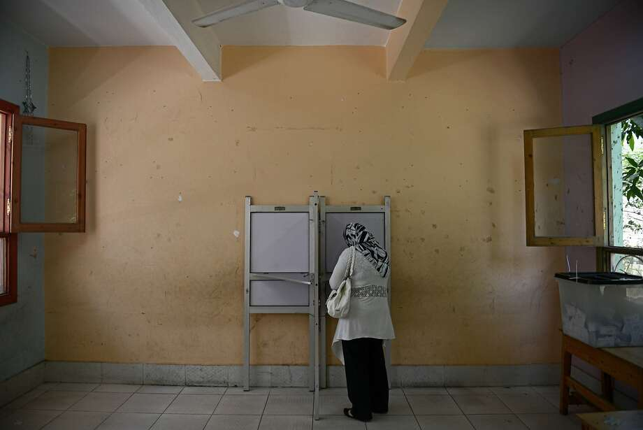 CAIRO, EGYPT - MAY 27:  An Egyptian voter selects a candidate in a polling station in the Cairo suburb of al-Manial on May 27, 2014 in Cairo, Egypt. Egypt will hold Presidential elections on 26th and 27th May for the first time since the military deposed President Morsi. There are only two candidates standing, Hamdeen Sabahi and Abdel Fattah al-Sisi with al- Sisi expected to win the election (Photo by Jonathan Rashad/Getty Images) *** BESTPIX *** Photo: Jonathan Rashad, Getty Images