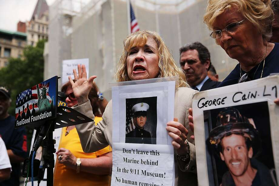 NEW YORK, NY - MAY 27:  Sally Regenhard, who lost her son on 9/11, speaks at a news conference with other family members on the steps of City Hall to criticize the placement of unidentified human remains beneath the newly opened National Sept. 11 Memorial and Museum on May 27, 2014 in New York City. The remains, including approximately 7,930 body parts, were moved in a formal procession to the bedrock level of the World Trade Center site in a burial vault. Some families would prefer for the remains to be moved to the memorial plaza. (Photo by Spencer Platt/Getty Images) Photo: Spencer Platt, Getty Images