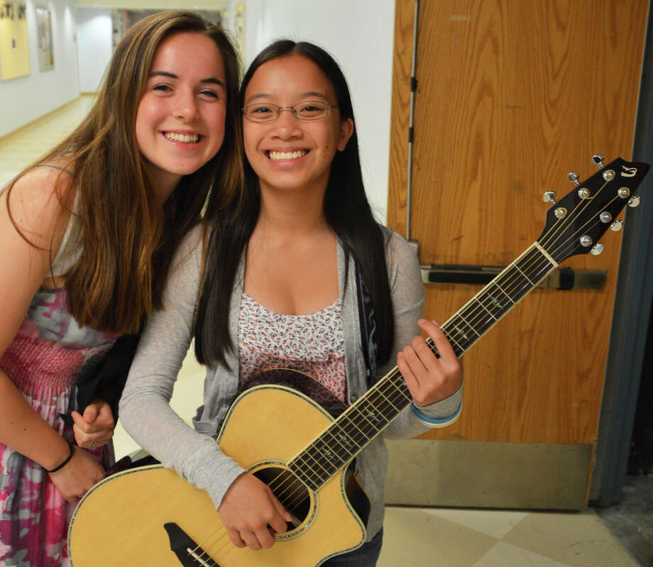 "Madeline Gray, left, and Sammi Ryan, both 16, performed Sarah Bearls' ""Love on the Rocks"" at the Staples High School talent show Tuesday. Photo: Jarret Liotta / Westport News"