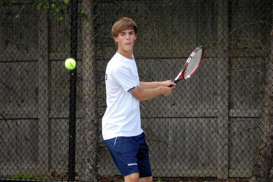 Staples senior Luke Foreman returns a shot against Greenwich's Ari Cepelewicz in the FCIAC semifinals on Tuesday. Foreman lost 6-4, 6-1. Photo: Keith Stein/Contributed / Westport News Contributed