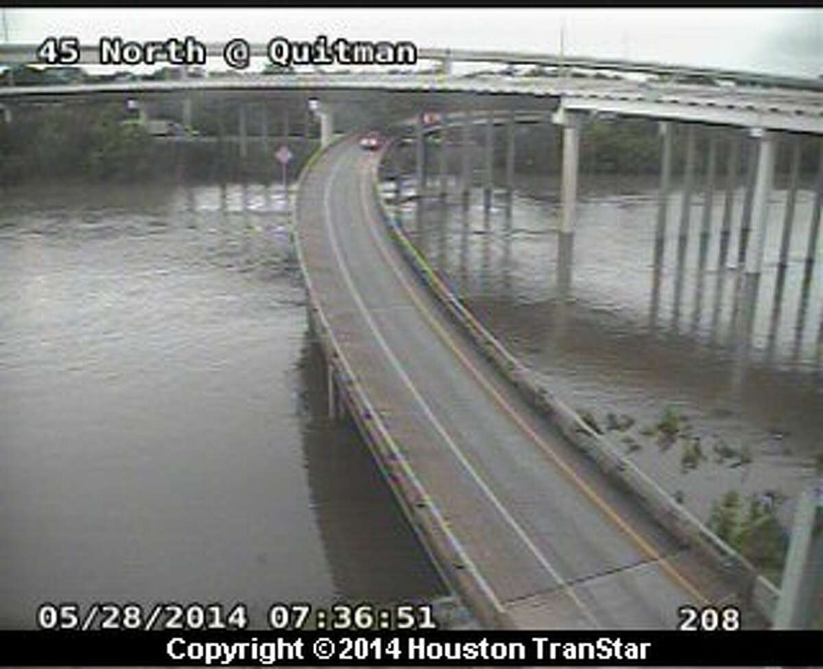 Houston TranStar cameras capture the rising waters of Buffalo Bayou early Wednesday morning along Interstate 45 and Quitman.