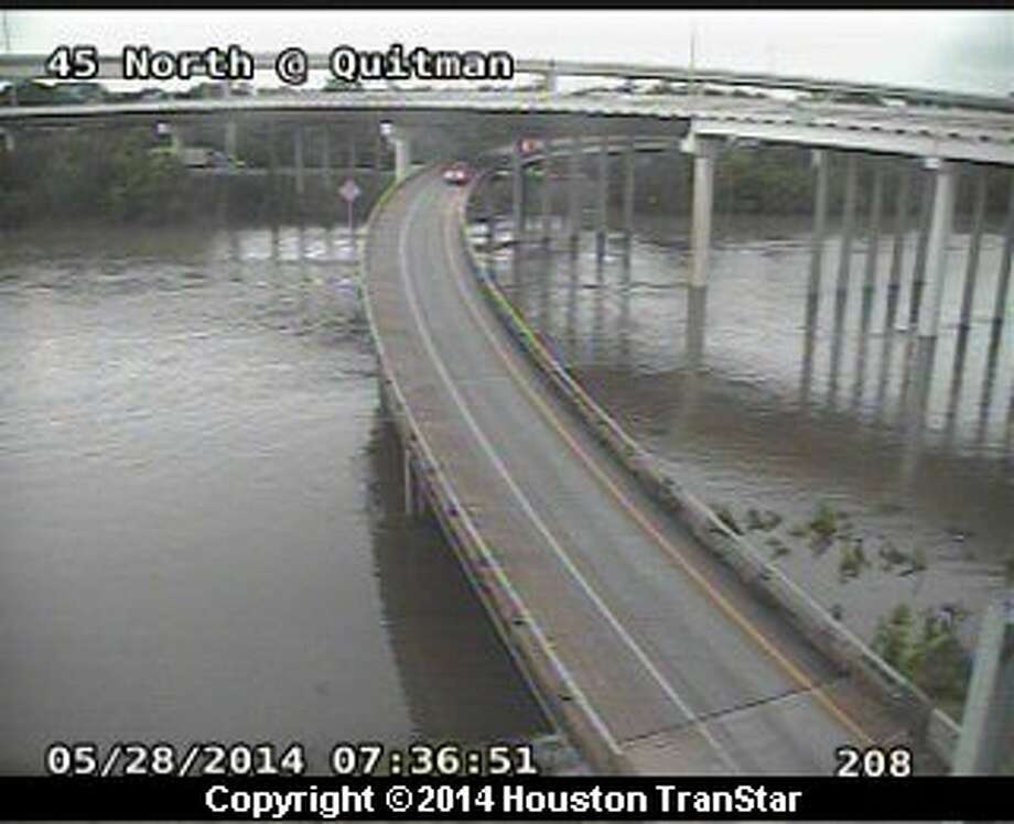 Houston TranStar cameras capture the rising waters of Buffalo Bayou early Wednesday morning along Interstate 45 and Quitman. Photo: Houston TranStar