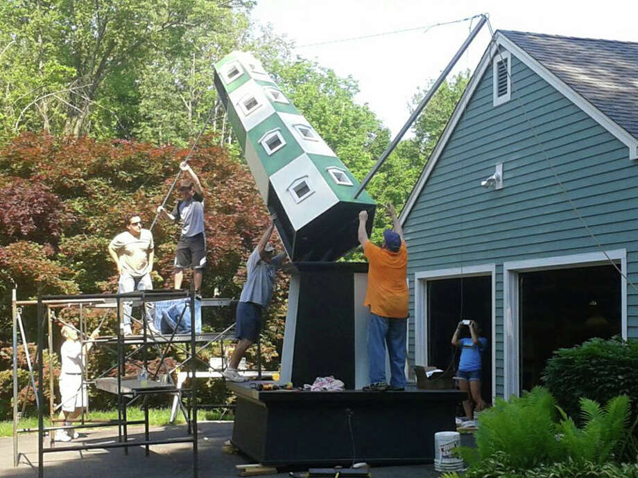 Ben's Lighthouse volunteers build a 20-foot lighthouse that will be part of  The Lighthouse Festival in Newtown on Saturday, June 15. Family fun will be featured at this free event, including interactive exhibits, music, theater, arts and more. Photo: Contributed Photo / The News-Times Contributed