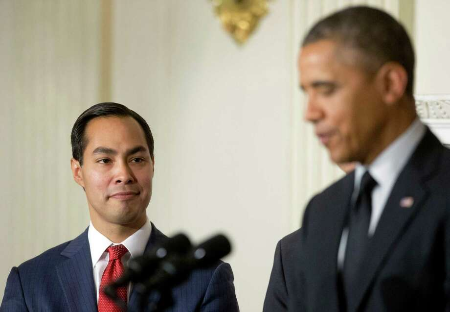 San Antonio Mayor Julian Castro, left, listens to President Barack Obama, right, announce his nomination to lead the Department of Housing and Urban Development (HUD) to replace current Secretary Shaun Donovan, in the State Dinning Room of the White House in Washington, Friday, May 23, 2014. (AP Photo/Pablo Martinez Monsivais) Photo: Pablo Martinez Monsivais, Associated Press / AP