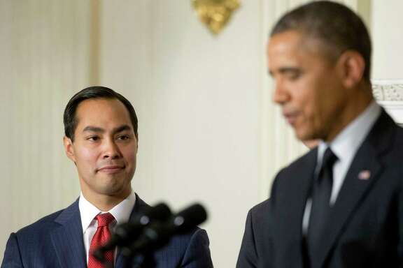 San Antonio Mayor Julian Castro, left, listens to President Barack Obama, right, announce his nomination to lead the Department of Housing and Urban Development (HUD) to replace current Secretary Shaun Donovan, in the State Dinning Room of the White House in Washington, Friday, May 23, 2014. (AP Photo/Pablo Martinez Monsivais)