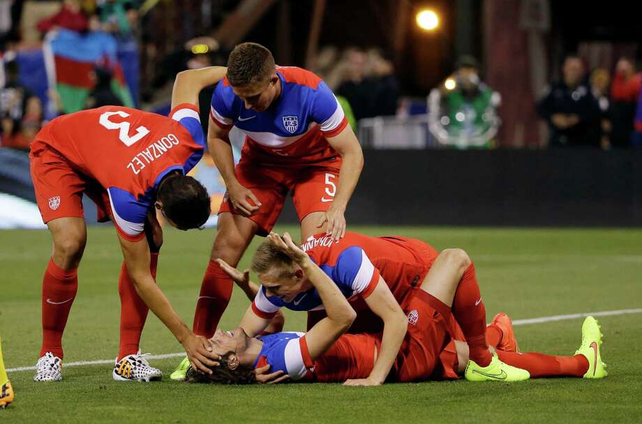 United States' Mix Diskerud, bottom, celebrates his goal with teammates during the second half of an international friendly soccer match against Azerbaijan on Tuesday, May 27, 2014, in San Francisco. United States won 2-0. (AP Photo/Marcio Jose Sanchez) Photo: Marcio Jose Sanchez, Associated Press / AP
