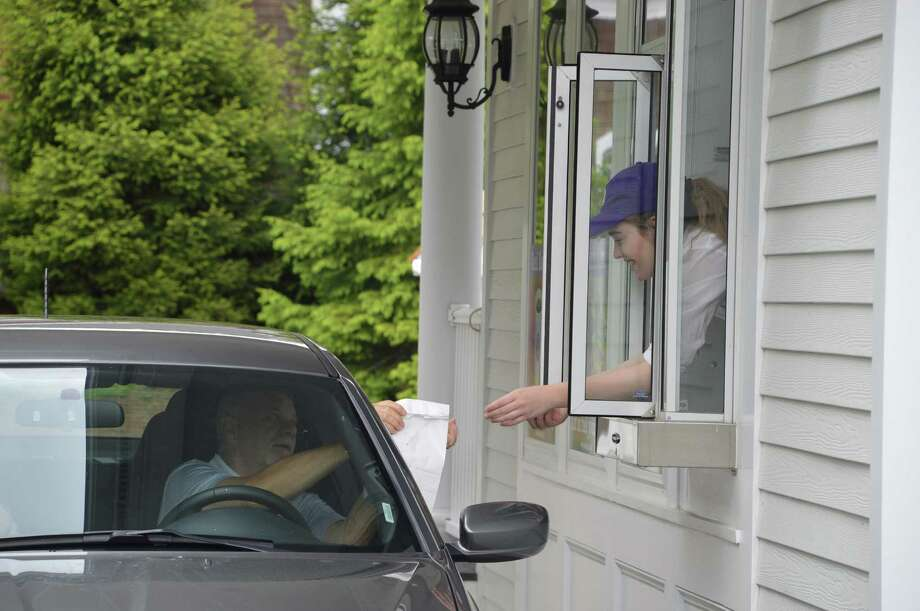 Myron Harvist, of South Carolina, gets his food from an employee at Palmwich Real Food Drive-Thru, which opened at 205 Boston Post Road in Darien. Jarret Liotta/For the Darien News Photo: Contributed Photo, Contributed / Darien News