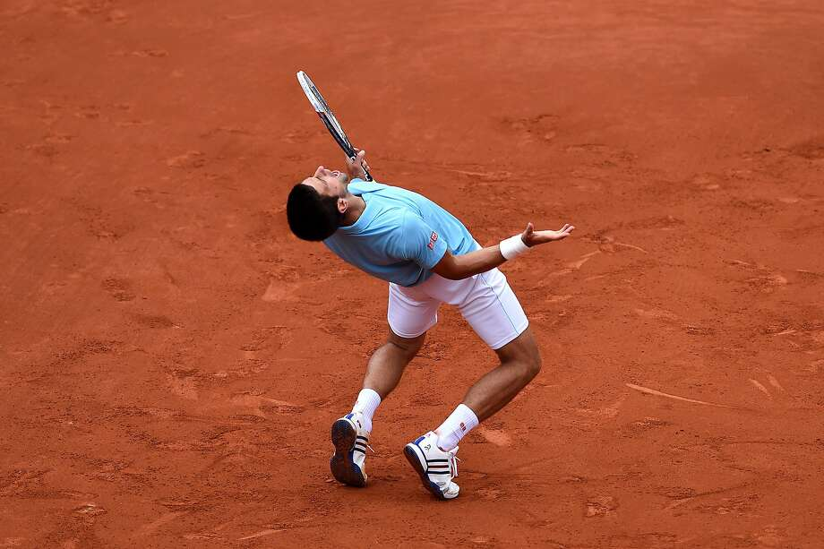 Novak Djokovic of Serbia celebrates a point during his men's singles match against Jeremy Chardy of France on day four of the French Open at Roland Garros on May 28, 2014 in Paris, France. Photo: Matthias Hangst, Getty Images