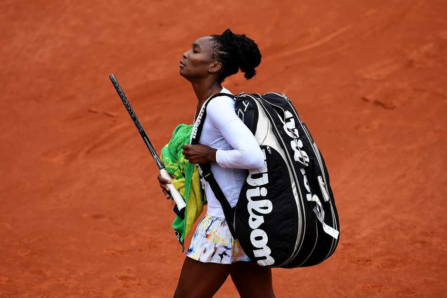PARIS, FRANCE - MAY 28:  Venus Williams of the United States walks off the court following her defeat in her women's singles match against Anna Schmiedlova of Slovakia on day four of the French Open at Roland Garros on May 28, 2014 in Paris, France.  (Photo by Matthias Hangst/Getty Images) Photo: Matthias Hangst, Getty Images