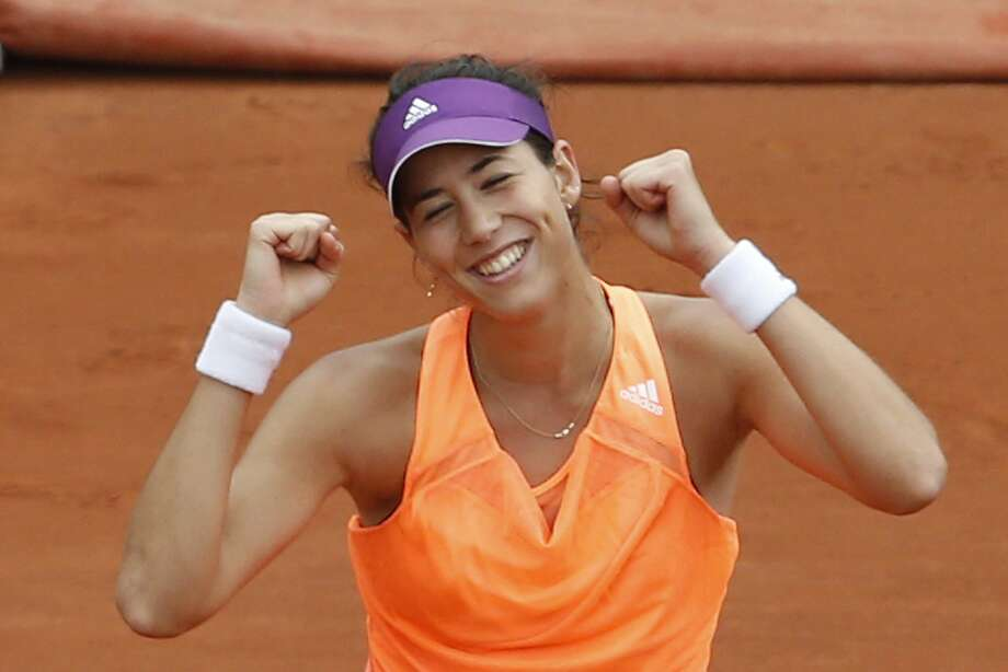 Spain's Garbine Muguruza celebrates winning the second round match of the French Open tennis tournament defeating Serena Williams of the U.S. in two sets 6-2, 6-2, at the Roland Garros stadium, in Paris, France, Wednesday, May 28, 2014. (AP Photo/Darko Vojinovic) Photo: Darko Vojinovic, Associated Press