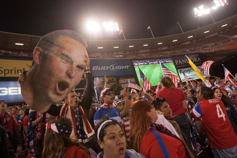 A USA fans cheers holding a large cutout of Landon Donovan's face  during the USA vs Azerbaijan game at Candlestick Park. Photo: Courtesy Douglas Zimmerman, Isiphotos.com