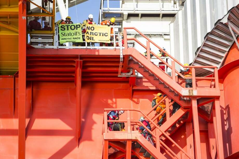 Greenpeace International activists from eight countries scale and occupy Statoil contracted oil rig Transocean Spitsbergen on May 27, 2014 to protest the company's plans to drill the northernmost well in the Norwegian Arctic at the Apollo Prospect of the Barents Sea, close to the Bear Island nature reserve. Photo: WILL ROSE, AFP/Getty Images