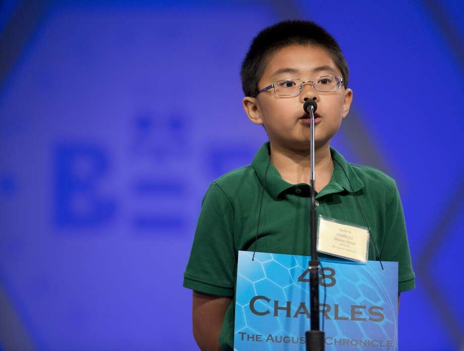 "Fifth grader Charles Sirui Li, 11, of Stevens Creek Elementary School, Martinez, Ga., spells his word ""jacamar"", during the preliminaries, round two of the Scripps National Spelling Bee, Wednesday, May 28, 2014, at National Harbor in Oxon Hill, Md. Li spelled his word correctly. Photo: Manuel Balce Ceneta, Associated Press"