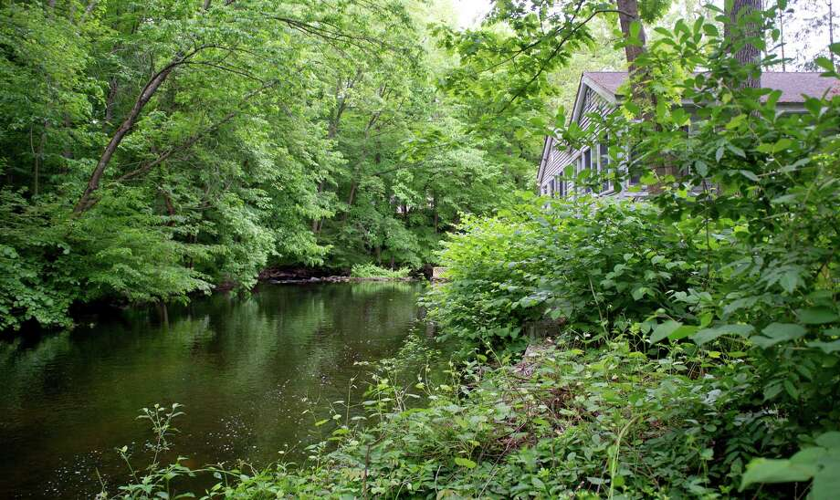 The Rippowam river runs behind the house at 115 Maltbie Ave. in Stamford, Conn., on Wednesday, May 28, 2014. Photo: Lindsay Perry / Stamford Advocate