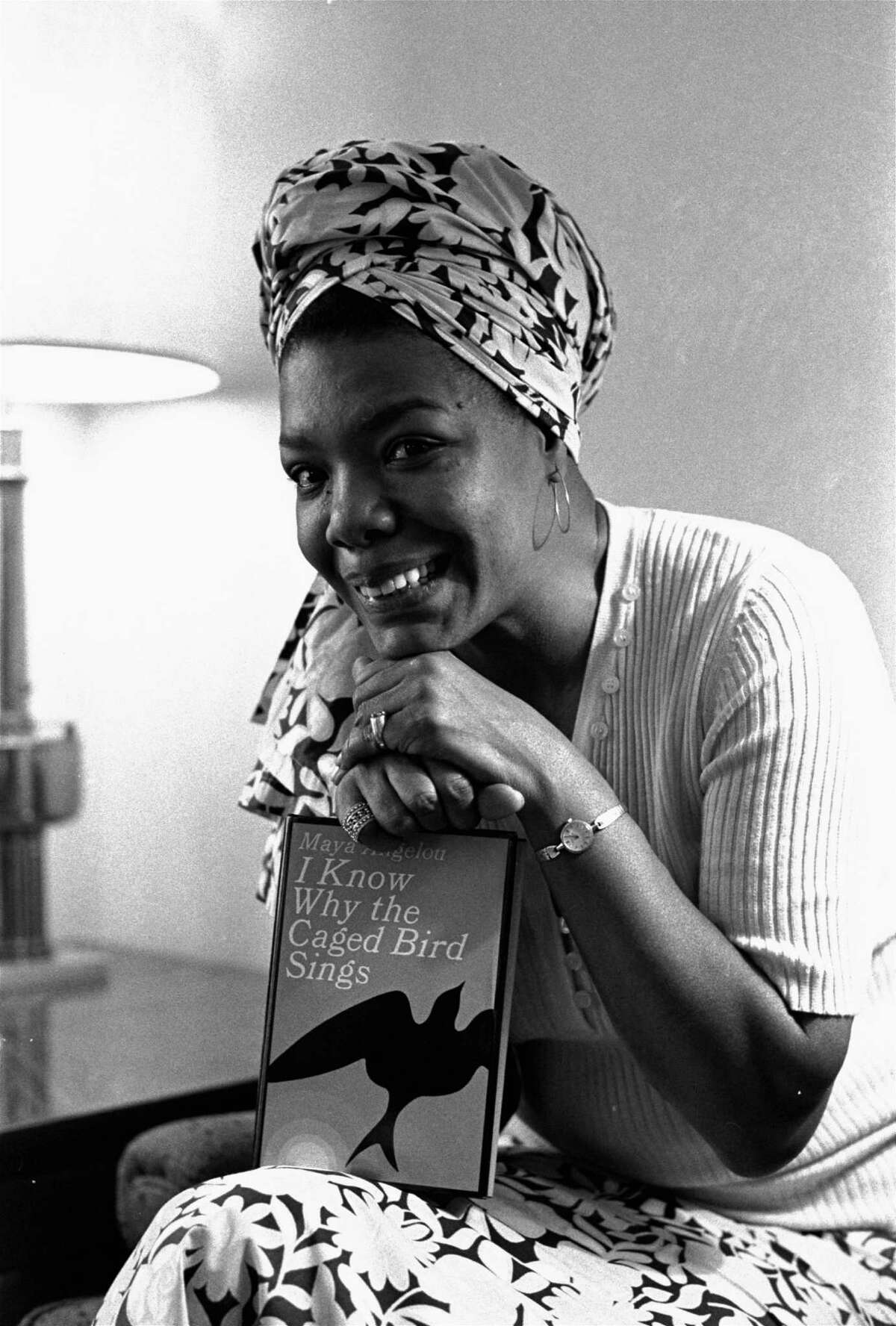 Maya Angelou poses with a copy of her autobiography in 1971.