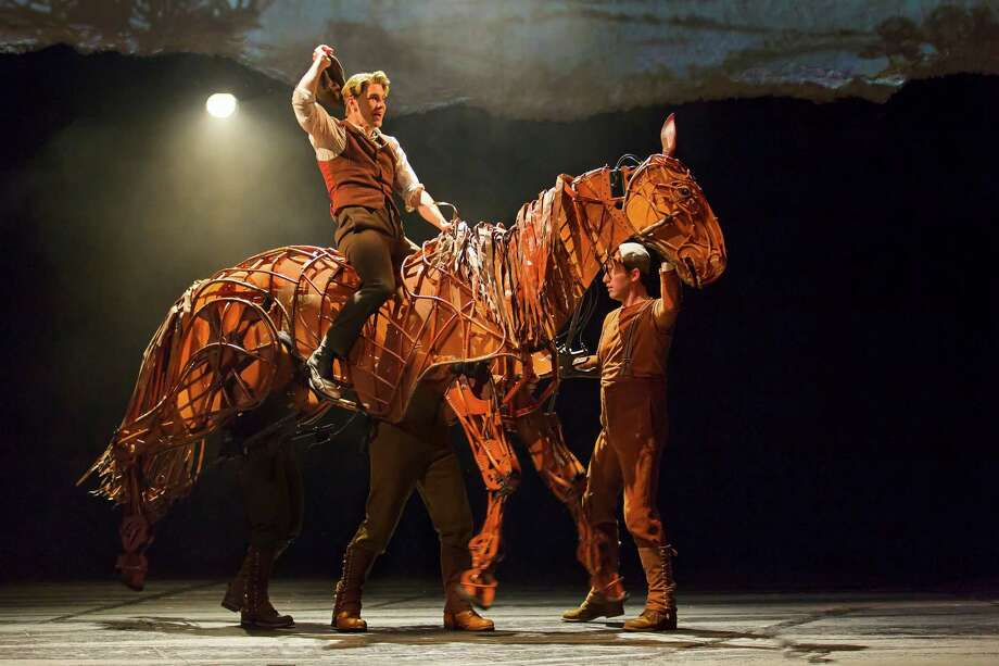 """In """"War Horse,"""" the star puppet Joey is strong enough to carry a human on its back. Three puppeteers manipulate the lifelike horse. Photo: Brinkhoff/Moegenburg / Brinkhoff/Moegenburg"""