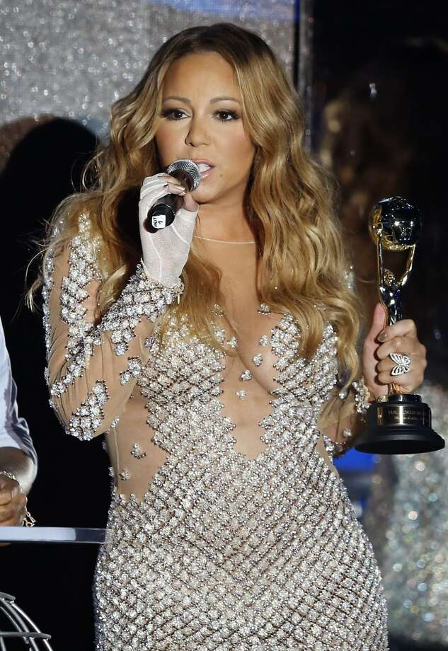 US singer Mariah Carey speaks after receiving an award during the World Music Awards at Monte Carlo Sporting Club, on May 27, 2014 in Monaco. Photo: VALERY HACHE, AFP/Getty Images