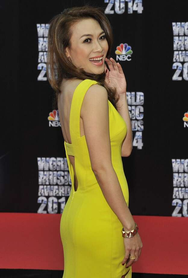 Vietnamese pop singer My Tam poses as she arrives for the World Music Awards in Monaco, Tuesday, May 27, 2014. Photo: Bruno Bebert, Associated Press